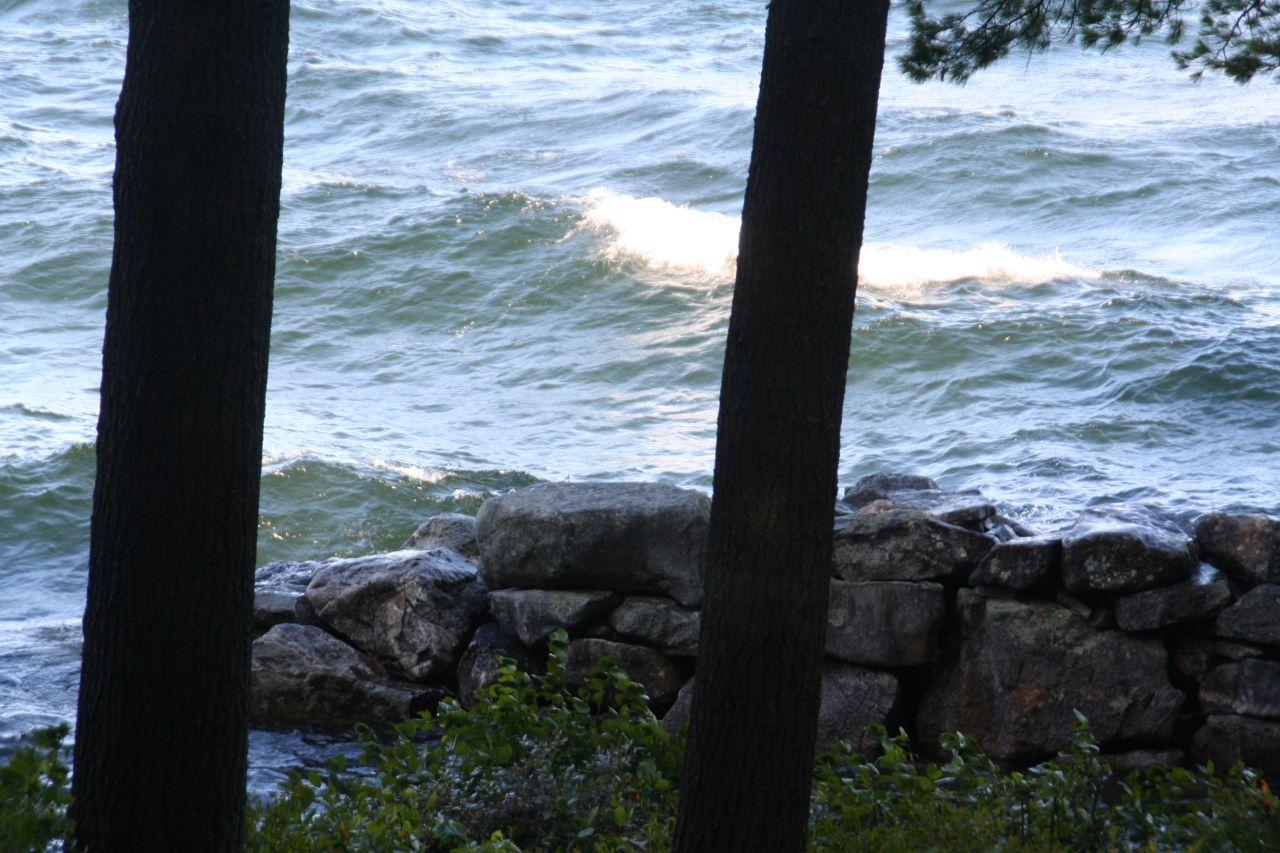 Waves crashing into the breakwater