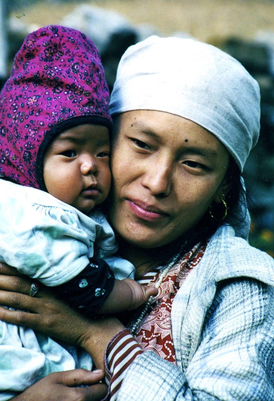 Tibetan mother and child in the valley refugee village
