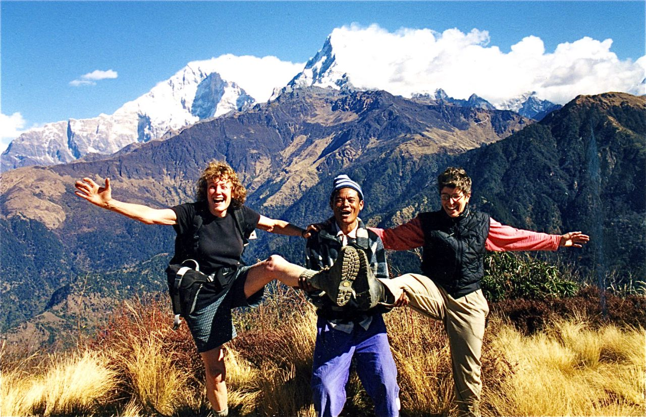 M.P., Kalu, and Denise kicking up our heels on Poon Hill